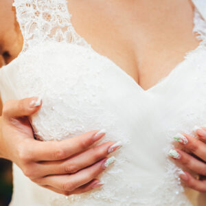 Closeup portrait of a bride with a bra problem.